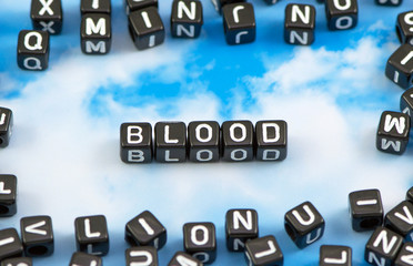 The word Blood on the sky background