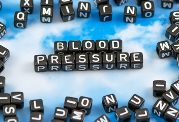 The word Blood pressure on the sky background