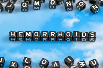 The word Hemorrhoids on the sky background