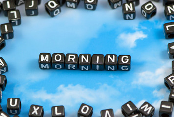The word morning on the sky background