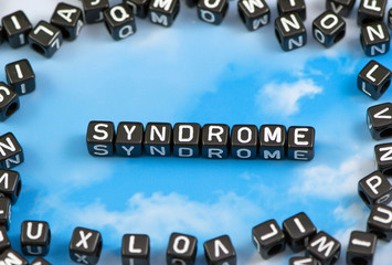 The word syndrome on the sky background
