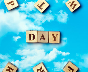 The word Day on the sky background