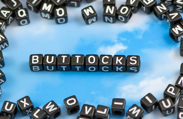 The word Buttocks on the sky background