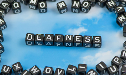 The word Deafness on the sky background