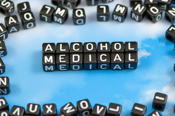 The word alcohol medical on the sky background