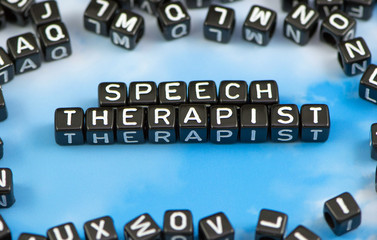 The word Speech therapist on the sky background