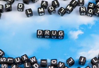 The word drug on the sky background