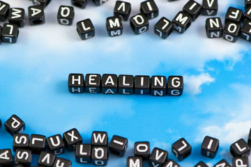 The word healing on the sky background