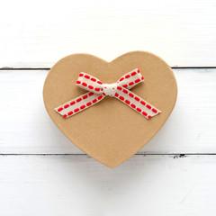 Vintage heart shape gift box on white wood background