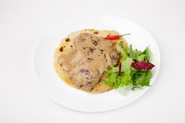 Beautiful meat dish on a white background