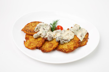 Jewish potato pancakes on white background
