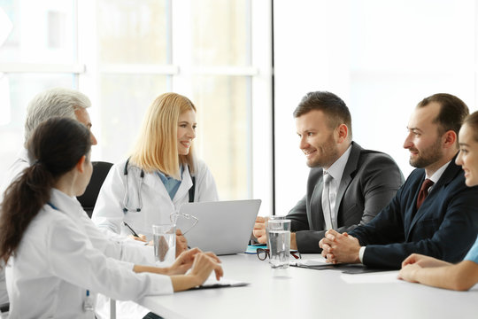 Team of doctors having meeting in clinic