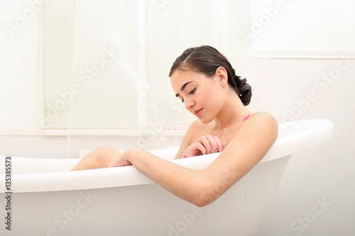 1ef5c5970b4 Young beautiful woman taking relaxing bath