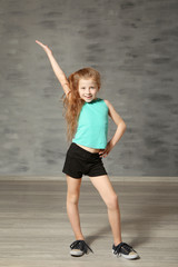 Cute funny girl in dance studio