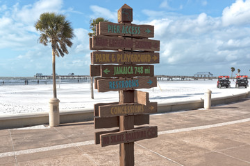 Sign on Clearwater Beach points tourist in right direction