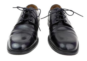 Isolated pair of black men's black dress shoes.