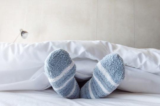Female foot in warm Stripe wool sock