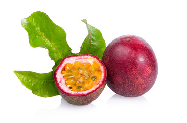 Passion fruit and leaf. Sliced Passiflora edulis fruits isolated