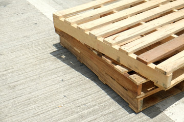 Two old pallets on the floor with space