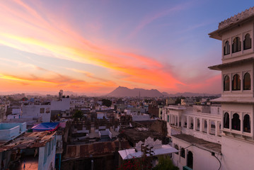 Udaipur cityscape with colorful sky at sunset, travel destination in Rajasthan, India
