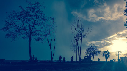 People silhouettes at a park in Moda, Istanbul city