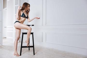 Attractive brunette standing in semi position