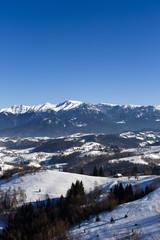 winter landscape with a mountain village in Romania