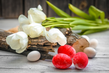 White tulips and red eggs