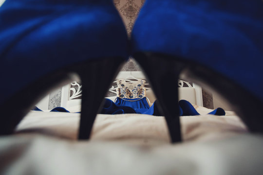 beautiful and glamorous evening blue dress lying on the bed