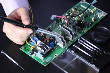 man hands chip soldering tools