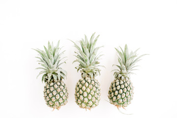 Pineapples on white background. Flat lay, top view. Creative food concept