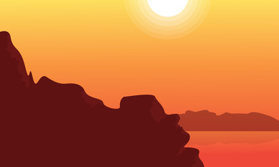 Silhouette of cliff and lake at sunset landscape