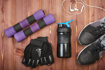Fitness equipment on wooden background.