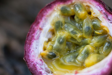 Macro shot of the cutted fresh passion fruit on rustic vintage w