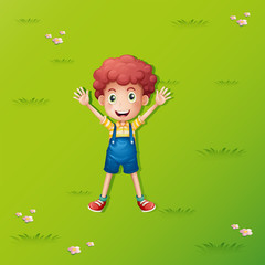 Little boy lying on the green grass