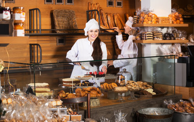Cafe staff offering cakes