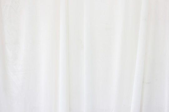 White curtain backdrop with light.