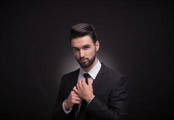 young man necktie tie a knot hands