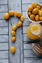 Question mark of Kumquat, oranges, lemons and fresh juice squeez