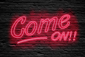 COME ON. fluorescent Neon tube Sign on dark brick wall. Front view. Can be used for online banner ads or background. night moment.