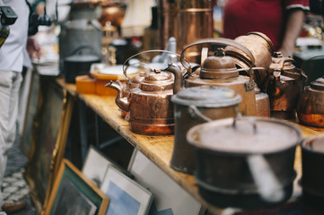 antique pans and pots at the street market in sweden Wall mural