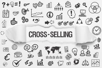Cross-Selling / weißes Papier mit Symbole