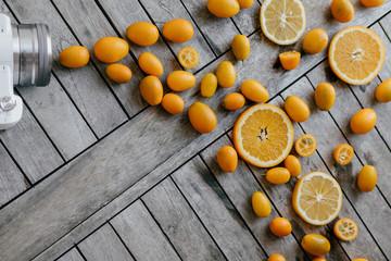 Healthy concept. Camera and mixed fruits: Kumquat, oranges, lemo