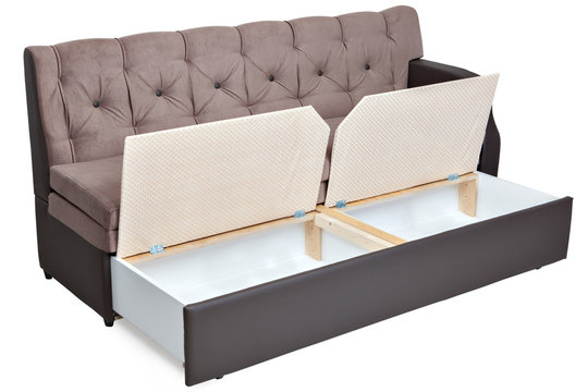 Folding light brown fabric sofa bed with storage.