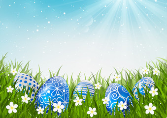 Blue Easter eggs on green grass