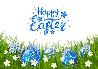 Blue Easter eggs on green grass