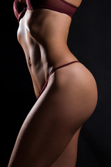 The slender figure of a woman in lingerie.