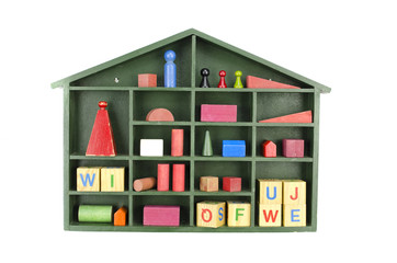 vintage green wooden box shelf with toys isolated