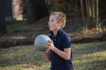 Boy playing ball. 10 years child playing basketball