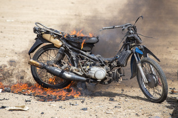 flame burned motorcycle from explosive in forensic training